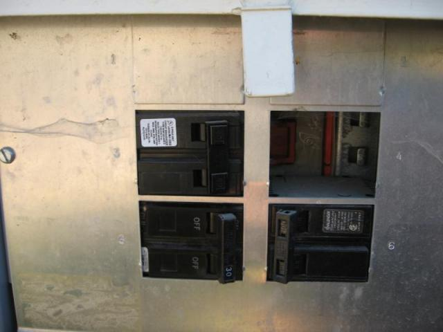 Open knockouts in electrical panel bent nail inspections for Best electrical panel for house